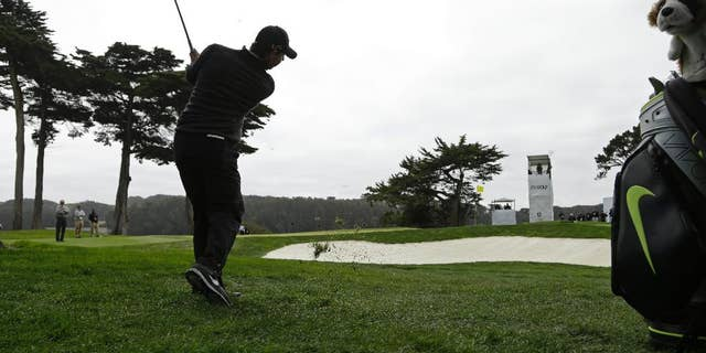 Rory McIlroy, of Northern Ireland, hits out of the rough to the 12th green during the Match Play Championship golf tournament at TCP Harding Park on Sunday, May 3, 2015, in San Francisco. McIlroy won the tournament. (AP Photo/Ben Margot)