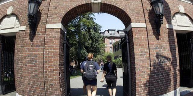 Students walking on Harvard University's campus in Cambridge, Massachusetts.