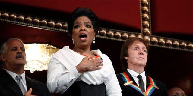 Oprah Winfrey and Paul McCartney. (AP)