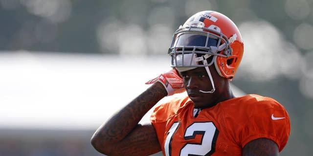 FILE - In this Aug. 4, 2014, file photo, Cleveland Browns wide receiver Josh Gordon rests during practice at the NFL football team's training campin Berea, Ohio. Gordon says the only place he can find peace is on the football field. His time there could be running short. The Browns' star receiver is awaiting word from the NFL on whether he'll be suspended for all or part of the season for violating the league's substance-abuse program. (AP Photo/Tony Dejak, File)