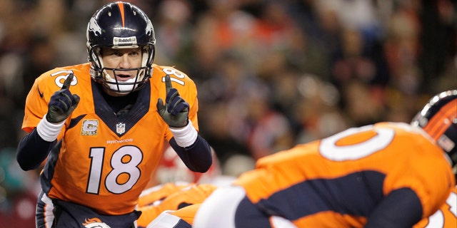 Denver Broncos quarterback Peyton Manning (18) calls an audible at the line of scrimmage against the Kansas City Chiefs in the first quarter of an NFL football game, Sunday, Nov. 17, 2013, in Denver. (AP Photo/Joe Mahoney)