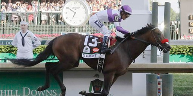 Mario Guitierrez rides Nyquist to victory during the 142nd running of the Kentucky Derby horse race at Churchill Downs Saturday, May 7, 2016, in Louisville, Ky. (AP Photo/Morry Gash)