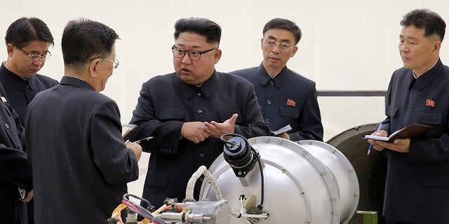 Kim Jong Un was pictured with what appeared to be a nuclear device after its sixth nuclear test in September.