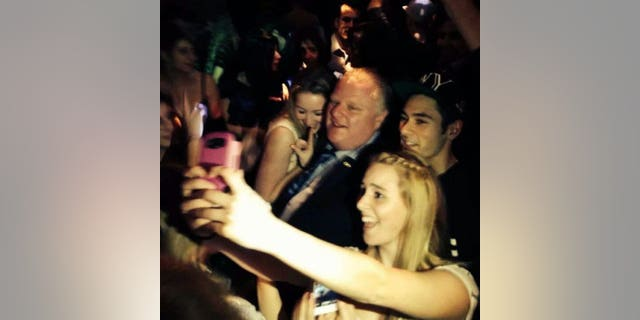 Toronto Mayor Rob Ford poses for photos at the Foggy Dew pub in Coquitlam, British Columbia, late Friday, Jan. 31, 2014.  Media reports say Ford was ticketed for jaywalking Friday night.  RCMP would not immediately comment to The Canadian Press about the reports, but Global News quoted a witness who said he saw the mayor ticketed. A spokesman for Ford could not immediately be reached for comment. Ford is reportedly in Vancouver for the funeral of a friend's mother.   (AP Photo/The Canadian Press, Catriona Korucu)