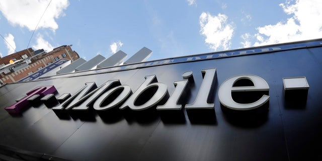 A T-Mobile store is shown in New York in this file photo. T-Mobile is being sued by a woman after a caretaker looking after her son was on hold while attempting to get in contact with 911.