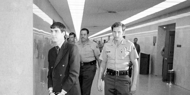 "In this Oct. 12, 1971 file photo, Charles ""Tex"" Watson, left, is led back to jail from a courtroom after he was convicted of seven counts of first degree murder and one of conspiracy to commit murder in the Tate-LaBianca slayings, in Los Angeles. California officials have denied parole for Watson, the self-described ""right-hand man"" of murderous cult leader Charles Manson. The decision came Thursday, Oct. 27, 2016, at the 17th parole hearing for Watson and 47 years after he helped plan and participated in the slayings of pregnant actress Sharon Tate and six others in 1969. (AP Photo/George Brich, File)"