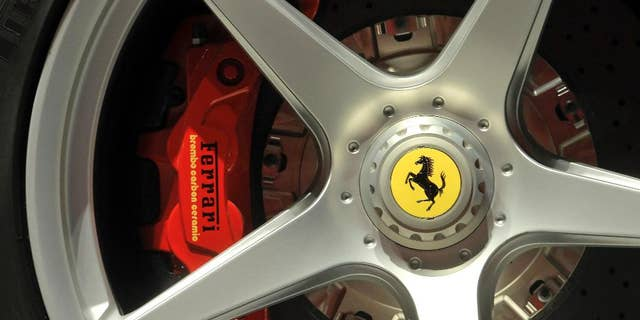 FILE - In this May 8, 2013 file photo a Ferrari logo is displayed on a wheel at the Ferrari factory in Maranello, Italy. Luxury Italian sports carmaker Ferrari has announced a record first quarter as sales of its V12 models boosted profits by 60 percent. (AP Photo/Marco Vasini, files)