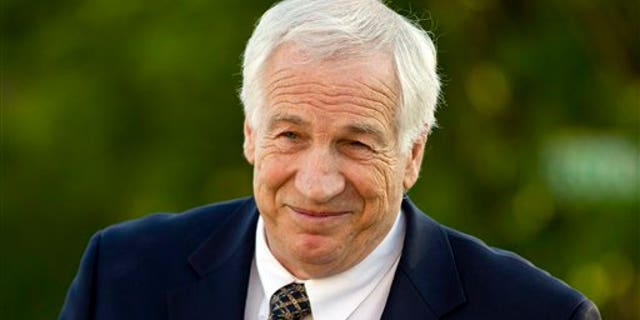 This April 5, 2012 file photo shows former Penn State assistant football coach Jerry Sandusky arriving at the Centre County Courthouse in Bellefonte, Pa.