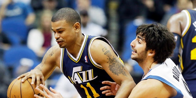 Earl Watson, left, playing for the Utah Jazz in 2013.
