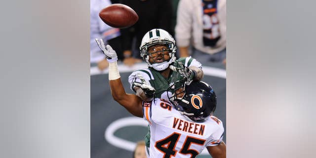 FILE - In a Sept. 22, 2014,  file photo, New York Jets wide receiver Jeremy Kerley goes up for a pass into the end zone against Chicago Bears strong safety Brock Vereen (45) during the fourth quarter of an NFL football game in East Rutherford, N.J.   The New York Jets announced Tuesday Oct. 21, 2014, they have signed  Kerley to a four-year contract extension. (AP Photo/Bill Kostroun, file)