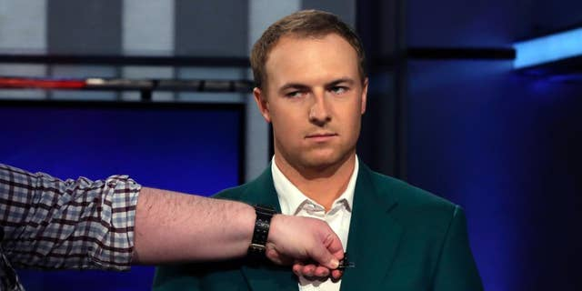 """Masters golf champion Jordan Spieth has his microphone attached to the lapel of his green jacket before his interview during the """"After the Bell"""" television program, on the Fox Business Network,  Tuesday, April 14, 2015, in New York. Nothing annoys the 21-year-old more than a nickname some players have given him — Golden Child. (AP Photo/Richard Drew)"""