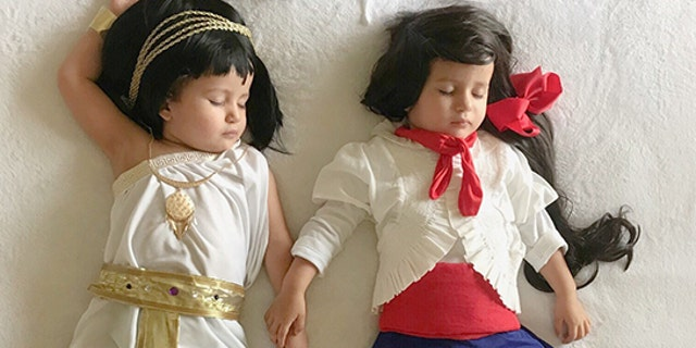 A mum has made her two-year-old twins homemade outfits to represent the opposing teams in every World Cup game.