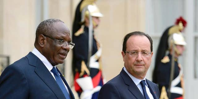 France President Francois Hollande (right) accompanies his Malian counterpart Ibrahim Boubacar at the Elysee palace in Paris on October 1st, 2013