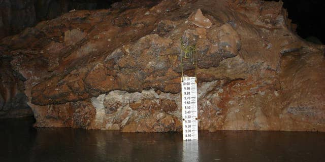 This 2006 photo provided by The National Park Service shows a gauge that measures the rise and fall of the Madison Aquifer water level at Calcite Lake in The Wind Cave National Park in the Black Hills of South Dakota. The underground lakes, which were discovered in the 1960s, aren't home to any animal life but prominent cave microbiologist Hazel Barton has discovered there is bacteria - albeit scant - in the lakes. Barton hopes to decipher how the bacteria survives and answer questions about how it interacted before multicellular organisms came along and perhaps find new sources of antibiotics. (The National Park Service via AP)