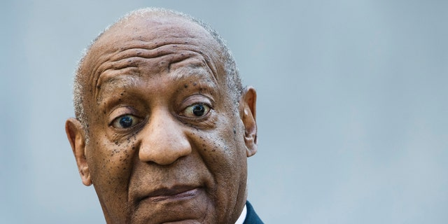 Bill Cosby walks from the Montgomery County Courthouse during his sexual assault trial in Norristown, Pa., Friday, June 9, 2017. (AP Photo/Matt Rourke)