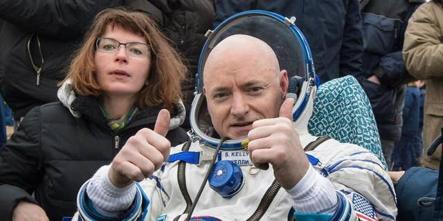 FILE - In this Wednesday, March 2, 2016, file photo provided by NASA, International Space Station (ISS) crew member Scott Kelly of the U.S. reacts after landing near the town of Dzhezkazgan, Kazakhstan.