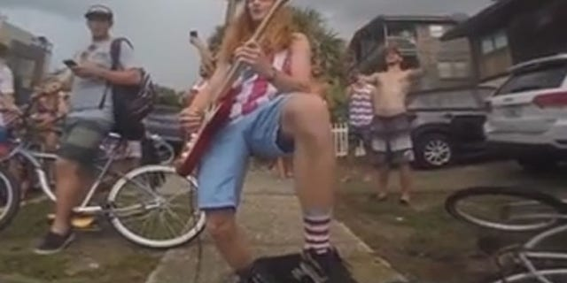 """Lane Pittman played """"The Star Spangled Banner"""" and Ted Nugent's """"Stranglehold"""" during a July 4 gathering. It led to applause -- and a citation from the cops."""