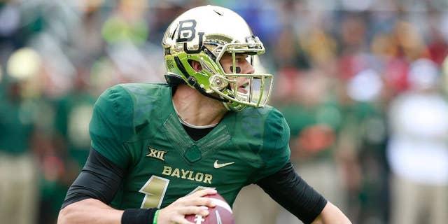 Baylor quarterback Bryce Petty (14) looks downfield against TCU in the first half of their NCAA college football game, Saturday, Oct. 11, 2014, in Waco, Texas. (AP Photo/Waco Tribune Herald, Jose Yau)