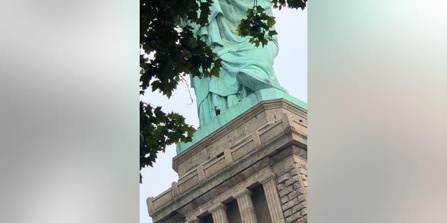"At least one person is scaling the Statue of Liberty after an ""Abolish ICE"" protest resulted in multiple arrests."
