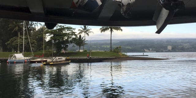 Damage can be seen to the roof of a tour boat after an explosion sent lava flying through the roof off the Big Island of Hawaii.