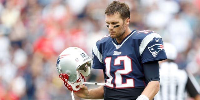 Sep 21, 2014; Foxborough, MA, USA; New England Patriots quarterback Tom Brady (12) reacts to a failed pass attempt during the fourth quarter against Oakland Raiders at Gillette Stadium. The New England Patriots won 16-9. Mandatory Credit: Greg M. Cooper-USA TODAY Sports