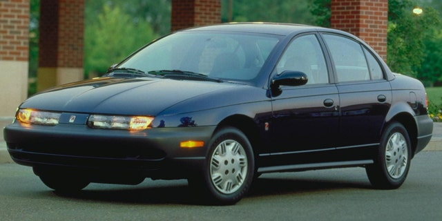 The boy stole a Saturn sedan like this one from a driveway when he found the keys inside of its cupholder.