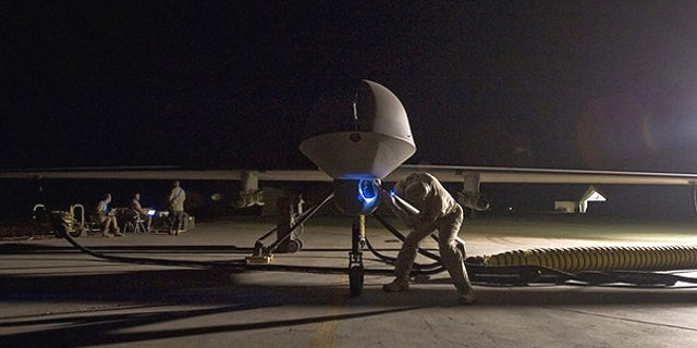 A pre-flight inspection of an MQ-1B Predator unmanned drone aircraft - file photo.
