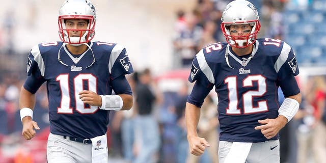 FOXBORO, MA - SEPTEMBER 21: Jimmy Garoppolo #10 and Tom Brady #12 of the New England Patriots warm up during pre-game before playing the Oakland Raiders at Gillette Stadium on September 21, 2014 in Foxboro, Massachusetts. (Photo by Jim Rogash/Getty Images)