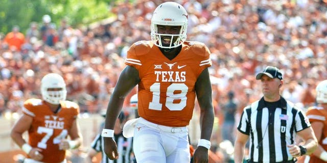 Sep 26, 2015; Austin, TX, USA; Texas Longhorns quarterback Tyrone Swoopes (18) reacts against the Oklahoma State Cowboys during the second quarter at Darrell K Royal-Texas Memorial Stadium. Mandatory Credit: Brendan Maloney-USA TODAY Sports