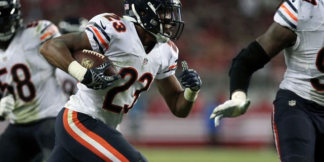 Sep 14, 2014; Santa Clara, CA, USA; Chicago Bears Kyle Fuller (23) runs after intercepting San Francisco 49ers quarterback Colin Kaepernick (7) (not pictured) in the fourth quarter of their NFL football game at Levis Stadium. Mandatory Credit: Lance Iversen-USA TODAY Sports