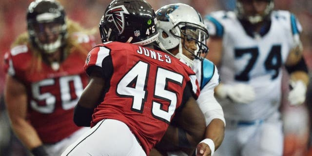 Carolina Panthers quarterback Cam Newton (1) is hit by Atlanta Falcons outside linebacker Deion Jones (45) during a two-point conversion during the second half of an NFL football game, Sunday, Oct. 2, 2016, in Atlanta. (AP Photo/Rainier Ehrhardt)