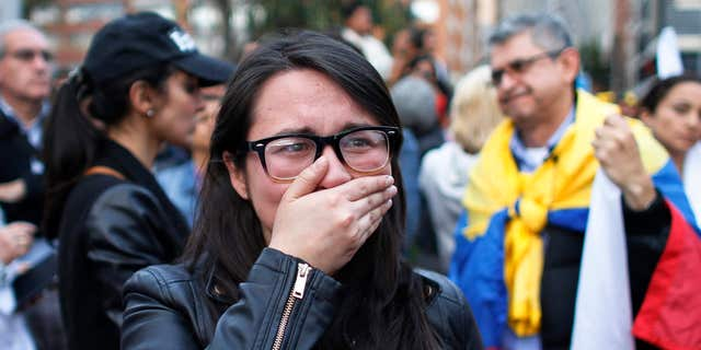 Oct. 2, 2016: A supporter of the peace accord signed between the Colombian government and rebels of the Revolutionary Armed Forces of Colombia, FARC, cries as she follows on a giant screen the results of a referendum to decide whether or not to support the deal in Bogota, Colombia,.