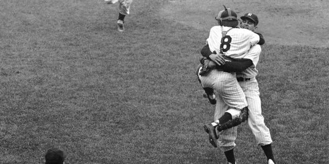 Don Larsen embraces Yogi Berra after the final out of Game 5 of the 1956 World Series. (Getty Images)