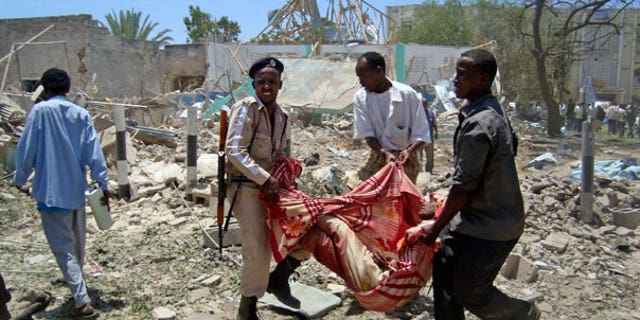 Oct. 4: Somalis carry the body of a man killed at the scene of an explosion in Mogadishu, Somalia.