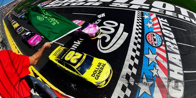 CHARLOTTE, NC - OCTOBER 11: Matt Kenseth, driver of the #20 Dollar General Toyota, and Kyle Busch, driver of the #18 M&M's Pretty In Pink Foundation Toyota, lead the field to the green flag to start the NASCAR Sprint Cup Series Bank of America 500 at Charlotte Motor Speedway on October 11, 2015 in Charlotte, North Carolina. (Photo by Robert Laberge/NASCAR via Getty Images)