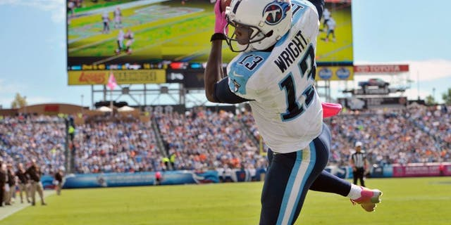 Oct 5, 2014; Nashville, TN, USA; Tennessee Titans wide receiver Kendall Wright (13) catches a touchdown pass against the Cleveland Browns during the first half at LP Field. Mandatory Credit: Jim Brown-USA TODAY Sports