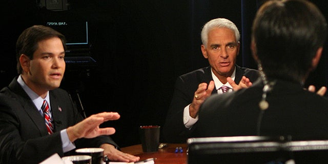 Oct. 6: Moderator George Stephanopoulos, foreground, tries to keep order during a contentious point with Senate candidates Marco Rubio, left, Charlie Crist and Kendrick Meek (unseen), during their debate in Orlando.