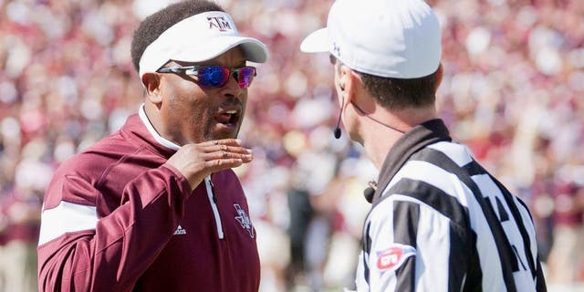 Oct 4, 2014; Starkville, MS, USA; Texas A&M Aggies head coach Kevin Sumlin discusses a play with an official during the game against the Mississippi State Bulldogs at Davis Wade Stadium. Mandatory Credit: Marvin Gentry-USA TODAY Sports