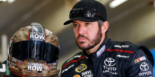CHARLOTTE, NC - OCTOBER 06: Martin Truex Jr, driver of the #78 Furniture Row/Denver Mattress Toyota, prepares to drive during practice for the NASCAR Sprint Cup Series Bank of America 500 at Charlotte Motor Speedway on October 6, 2016 in Charlotte, North Carolina. (Photo by Jonathan Ferrey/NASCAR via Getty Images)