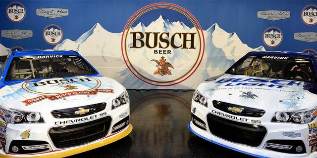 KANNAPOLIS, NC - OCTOBER 08: The #4 Busch Chevrolet and the #4 Busch Light Chevrolet sit in the auditorium after a press conference with Busch and Stewart-Haas Racing at Charlotte Motor Speedway on October 8, 2015 in Kannapolis, North Carolina. The brand will return to NASCAR, reigniting its storied history in the sport by sponsoring Kevin Harvick and the No. 4 team of Stewart-Haas Racing for select races beginning with the 2016 NASCAR Sprint Cup Series season. (Photo by Jared C. Tilton/Getty Images for Stewart-Haas Racing)