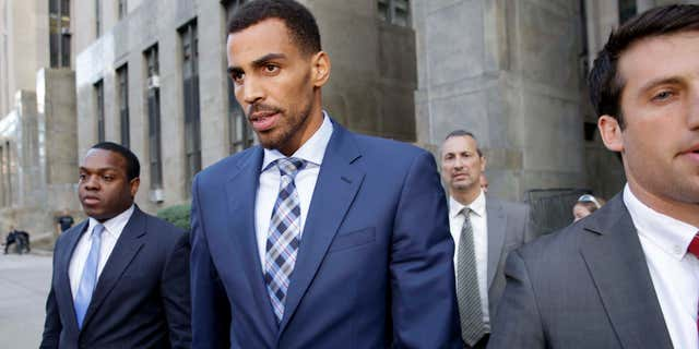 Oct. 7, 2015: Thabo Sefolosha, second from left, leaves criminal court in New York. (Associated Press)