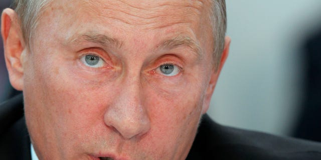 Russian Prime Minister Vladimir Putin attends a United Russia party's congress in Moscow on Friday, Sept. 23, 2011.