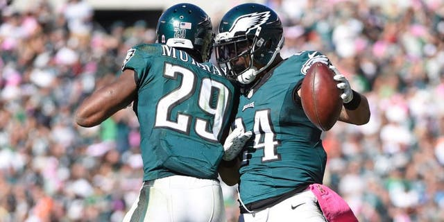 Oct 11, 2015; Philadelphia, PA, USA; Philadelphia Eagles running back DeMarco Murray (29) and running back Ryan Mathews (24) celebrate a touchdown during the third quarter against the New Orleans Saints at Lincoln Financial Field. Mandatory Credit: Eric Hartline-USA TODAY Sports
