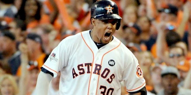 HOUSTON, TX - OCTOBER 11: Carlos Gomez #30 of the Houston Astros reacts after hitting an RBI single in the sixth inning against the Kansas City Royals in game three of the American League Division Series at Minute Maid Park on October 11, 2015 in Houston, Texas. (Photo by Eric Christian Smith/Getty Images)