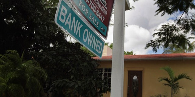 Sept. 16: A bank owned sign is seen in front of a foreclosed home in Miami.