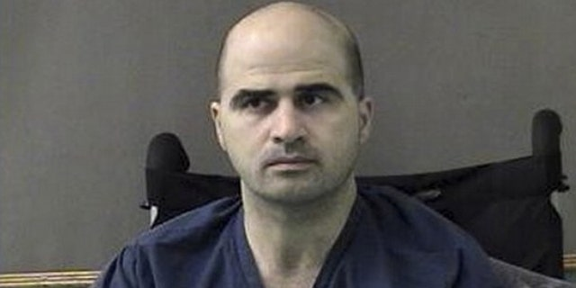 This April 9, 2010, file photo released by the Bell County Sheriffs Department shows Maj. Nidal Hasan at the Bell County Jail in Belton, Texas.