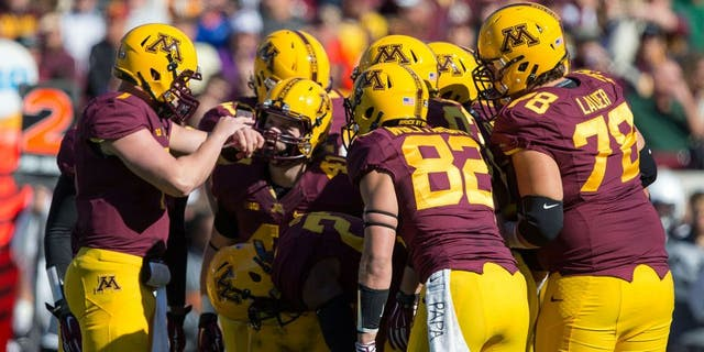 Oct 11, 2014; Minneapolis, MN, USA; Minnesota Golden Gophers quarterback Mitch Leidner (7) calls out a play to the rest of the Minnesota Golden Gophers offense in first half against the Northwestern Wildcats at TCF Bank Stadium. Mandatory Credit: Jesse Johnson-USA TODAY Sports