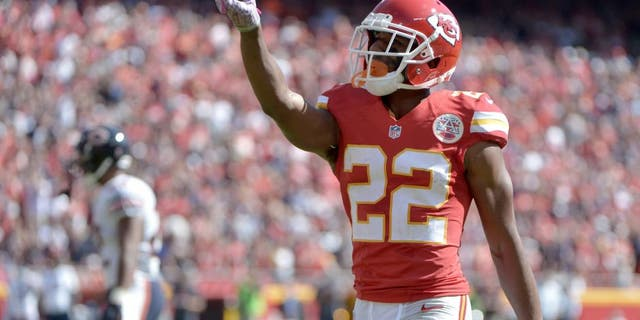 Oct 11, 2015; Kansas City, MO, USA; Kansas City Chiefs cornerback Marcus Peters (22) celebrates after breaking up a pass during the first half against the Chicago Bears at Arrowhead Stadium. Mandatory Credit: Denny Medley-USA TODAY Sports