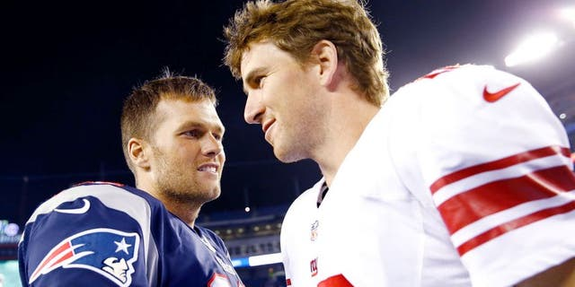 FOXBORO, MA - AUGUST 29: Tom Brady #12 of the New England Patriots talks to Eli Manning #10 of the New York Giants following their preseason game at Gillette Stadium on August 29, 2013 in Foxboro, Massachusetts. (Photo by Jared Wickerham/Getty Images)