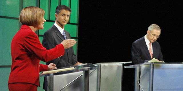 Oct. 14: Republican Senate candidate Sharron Angle, left debates Senate Majority Leader Harry Reid in Las Vegas.